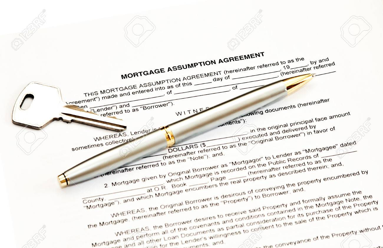 Mortgage Assumption Agreement With A Pen For Signature And A Stock