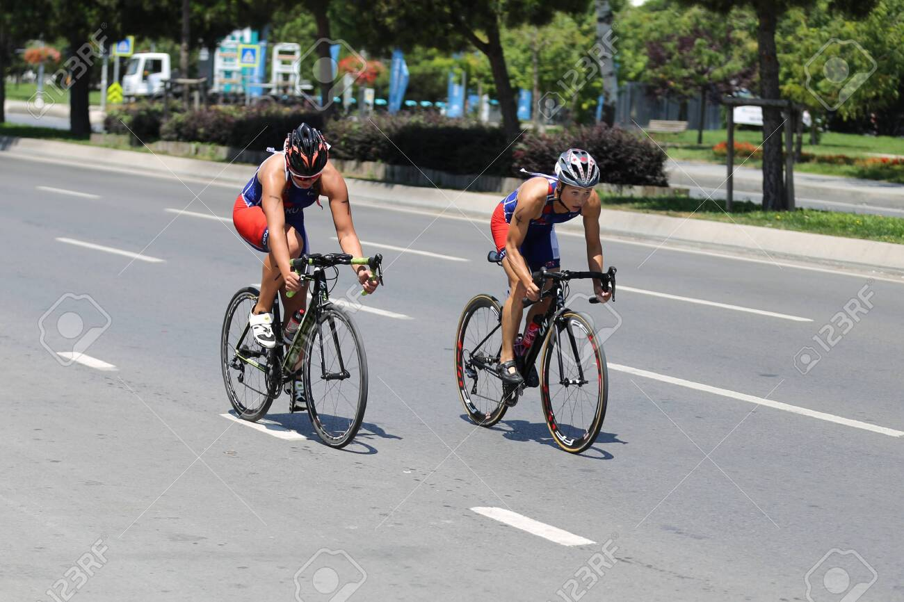 ISTANBUL, TURKEY - AUGUST 03, 2019: Athletes competing in cycling component of Istanbul ETU Triathlon Balkan Championships - 140481326