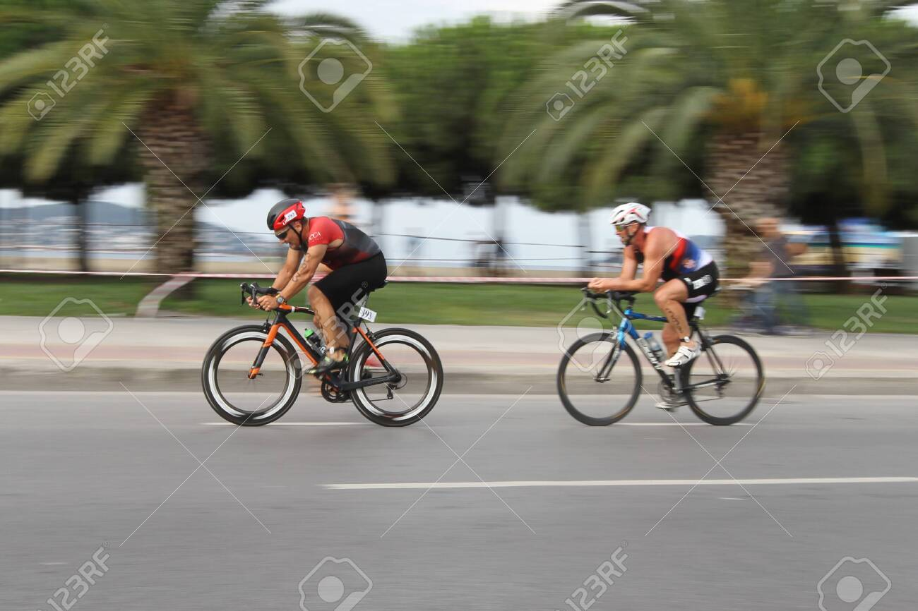 ISTANBUL, TURKEY - AUGUST 04, 2019: Athletes competing in cycling component of Istanbul ETU Triathlon Balkan Championships - 140481236