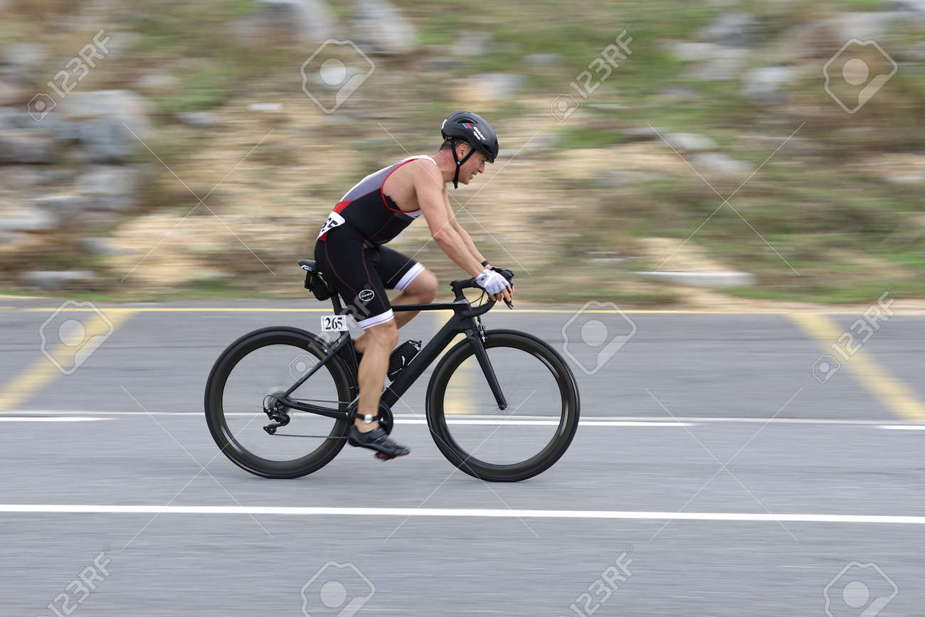 ISTANBUL, TURKEY - OCTOBER 18, 2020: Undefined athlete competing in cycling component of Istanbul Sprint Triathlon - 159561794