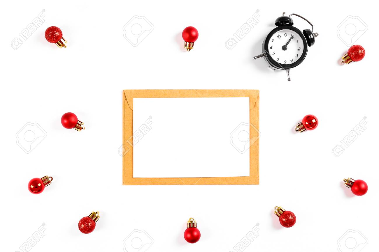 festive flat lay composition with blank invitation for new year celebration and craft paper envelope