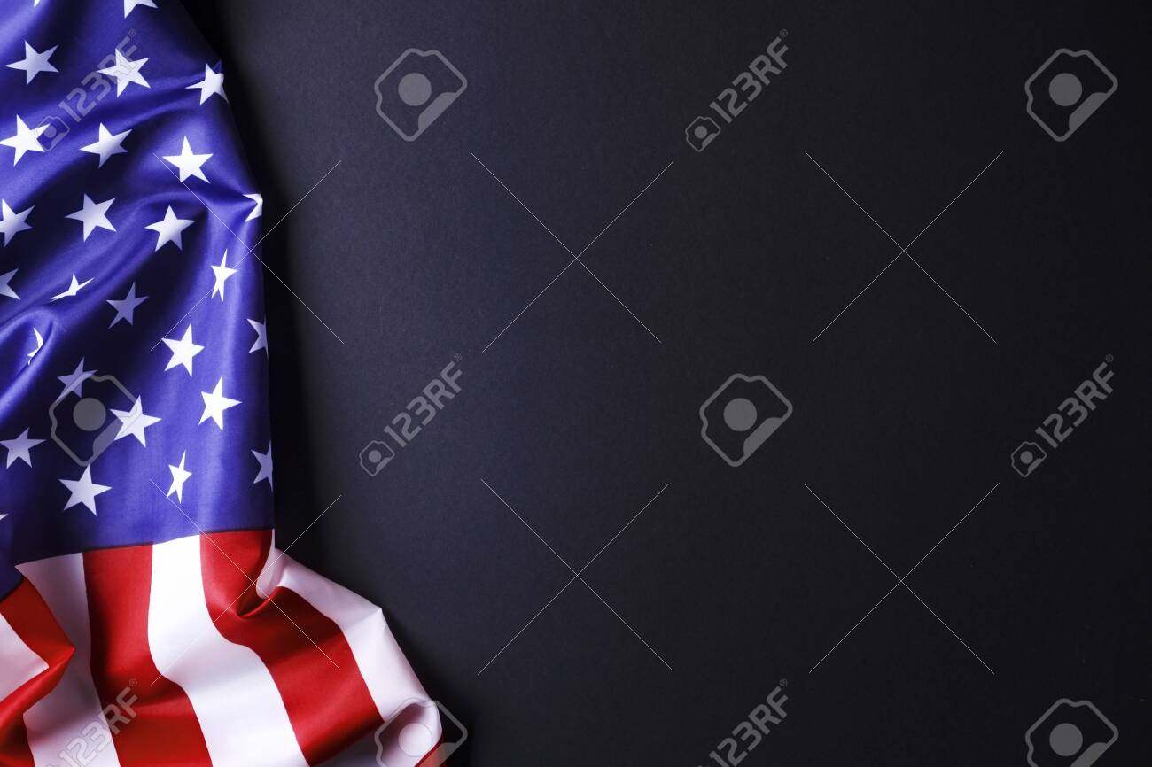 Patriotic Christmas Background.Patriotic Composition W Ruffled American Flag On Black Background