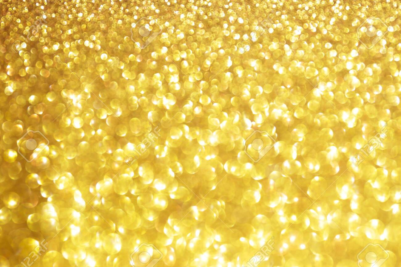 Golden sparkle glitters with bokeh effect and selectieve focus. Festive background with bright gold lights, champagne bubble. Christmas mood concept. Copy space, close up, texture, top view. - 153915066
