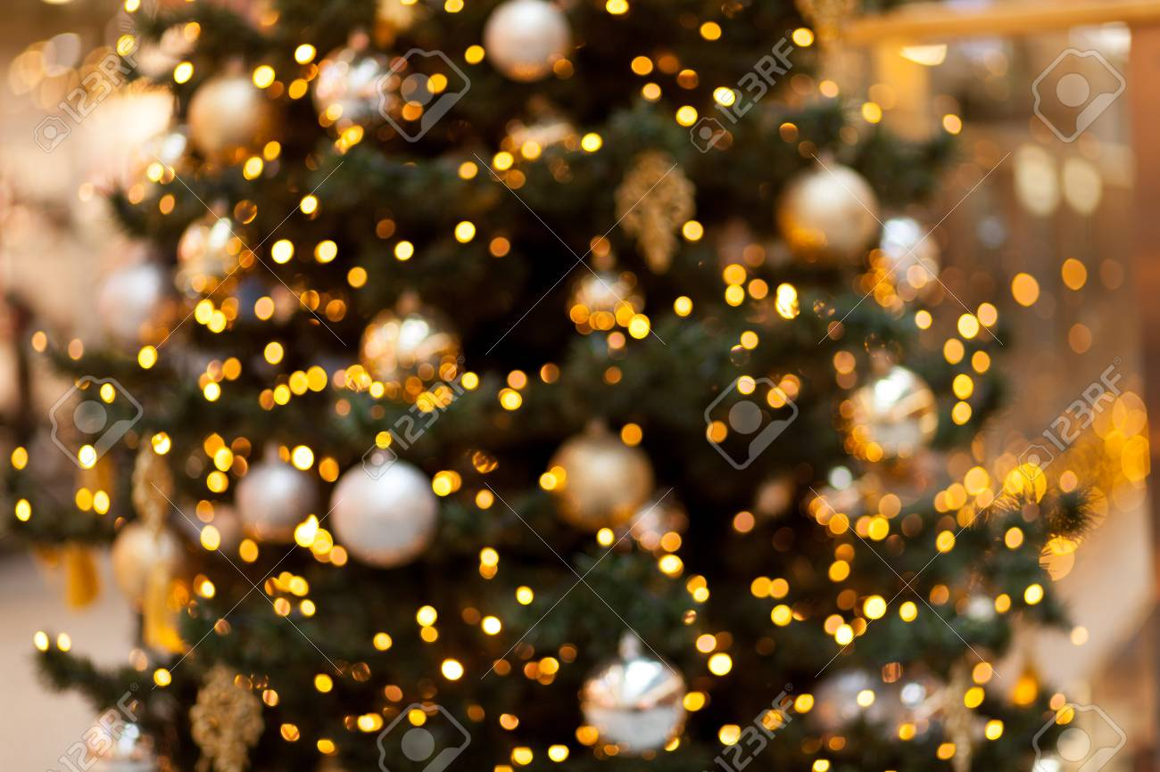 Yellow Lights Of A Tree Garland Abstract Blurred Christmas Background