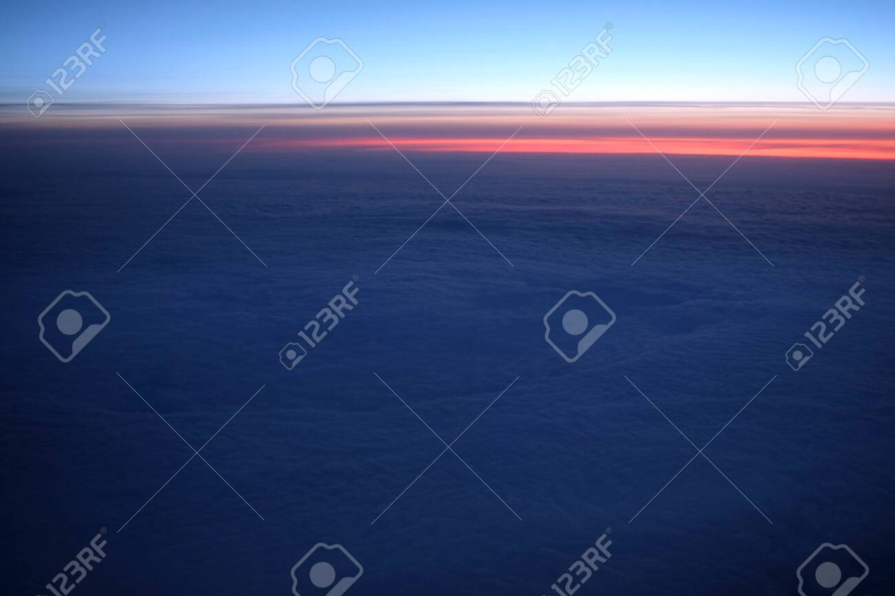 Aerial View Through Airplane Porthole Of Purple Sunset In Sky Stock Photo Picture And Royalty Free Image Image 133412424