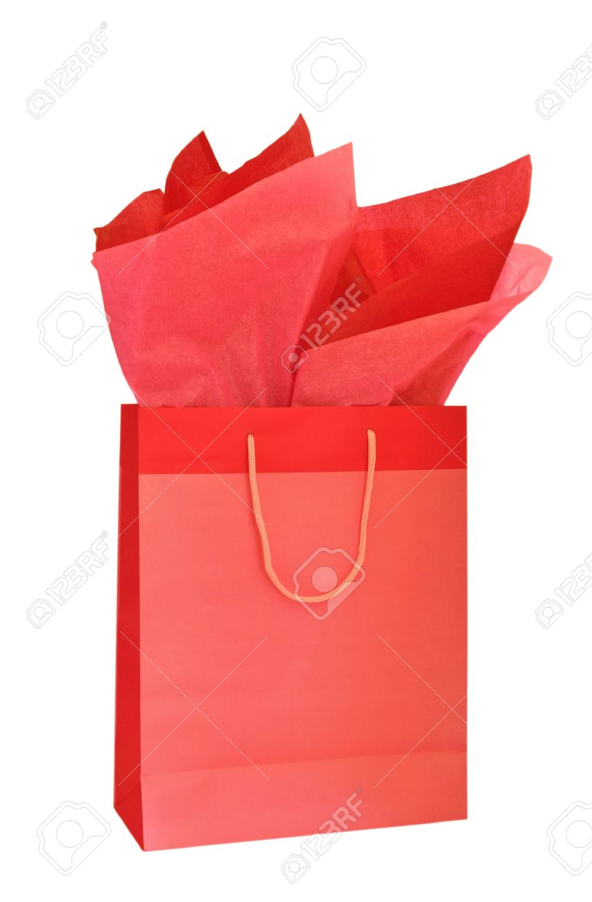 red christmas gift bag with tissue paper isolated on white