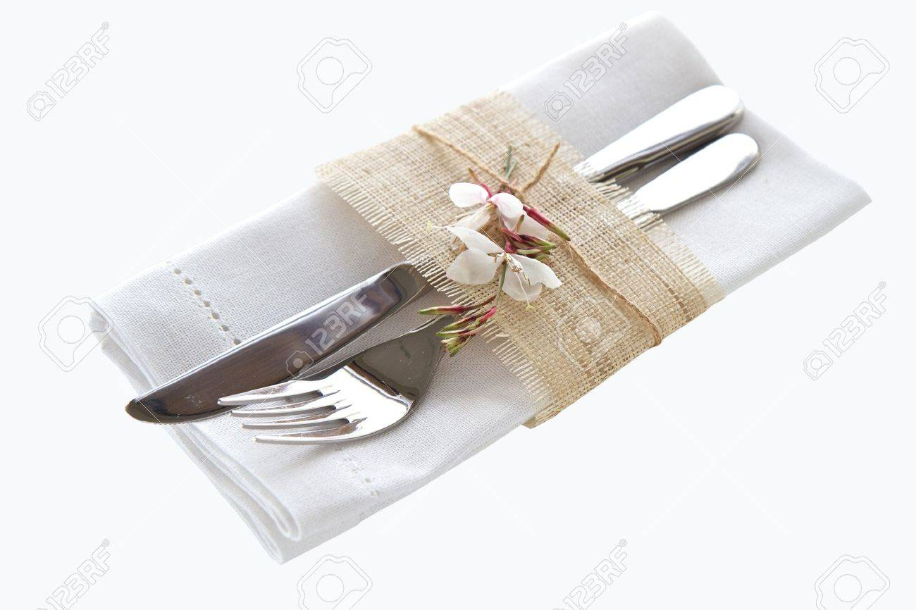 Knife and fork with napkin isolated on white background Stock Photo - 12848223