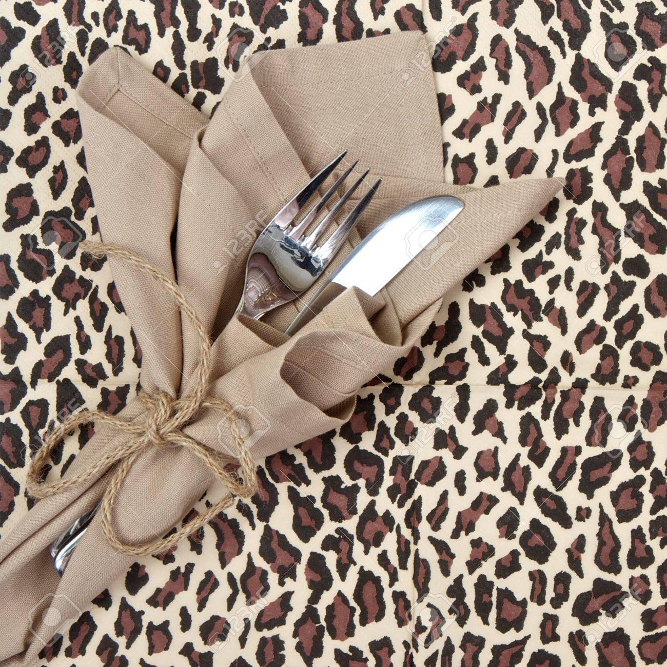 Knife And Fork With Animal Print Tablecloth Stock Photo   14704482