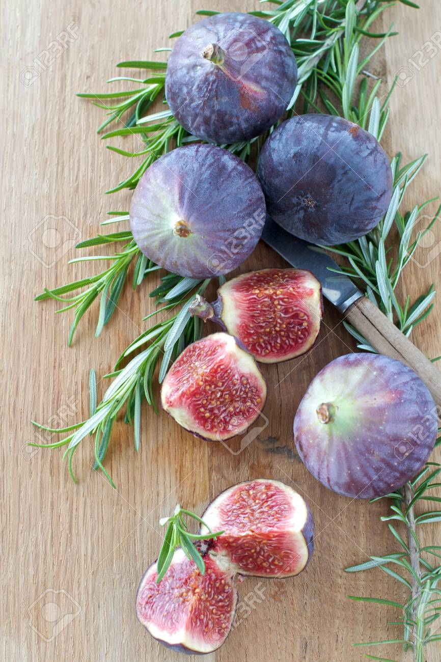 Fresh Figs and Rosemary on a wooden board Stock Photo - 15734922