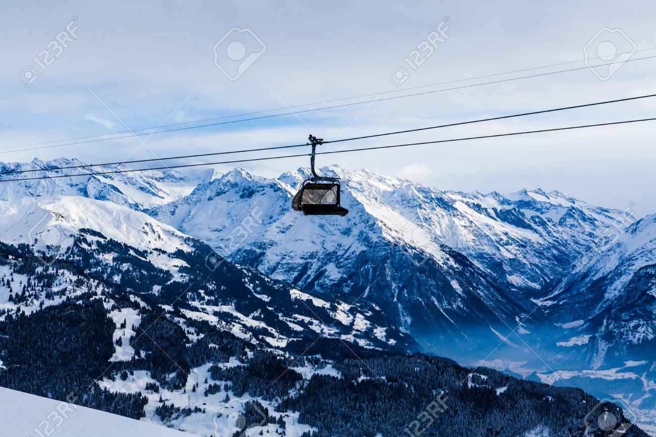 mountains ski resort. cable car. winter in the swiss alps. mountain