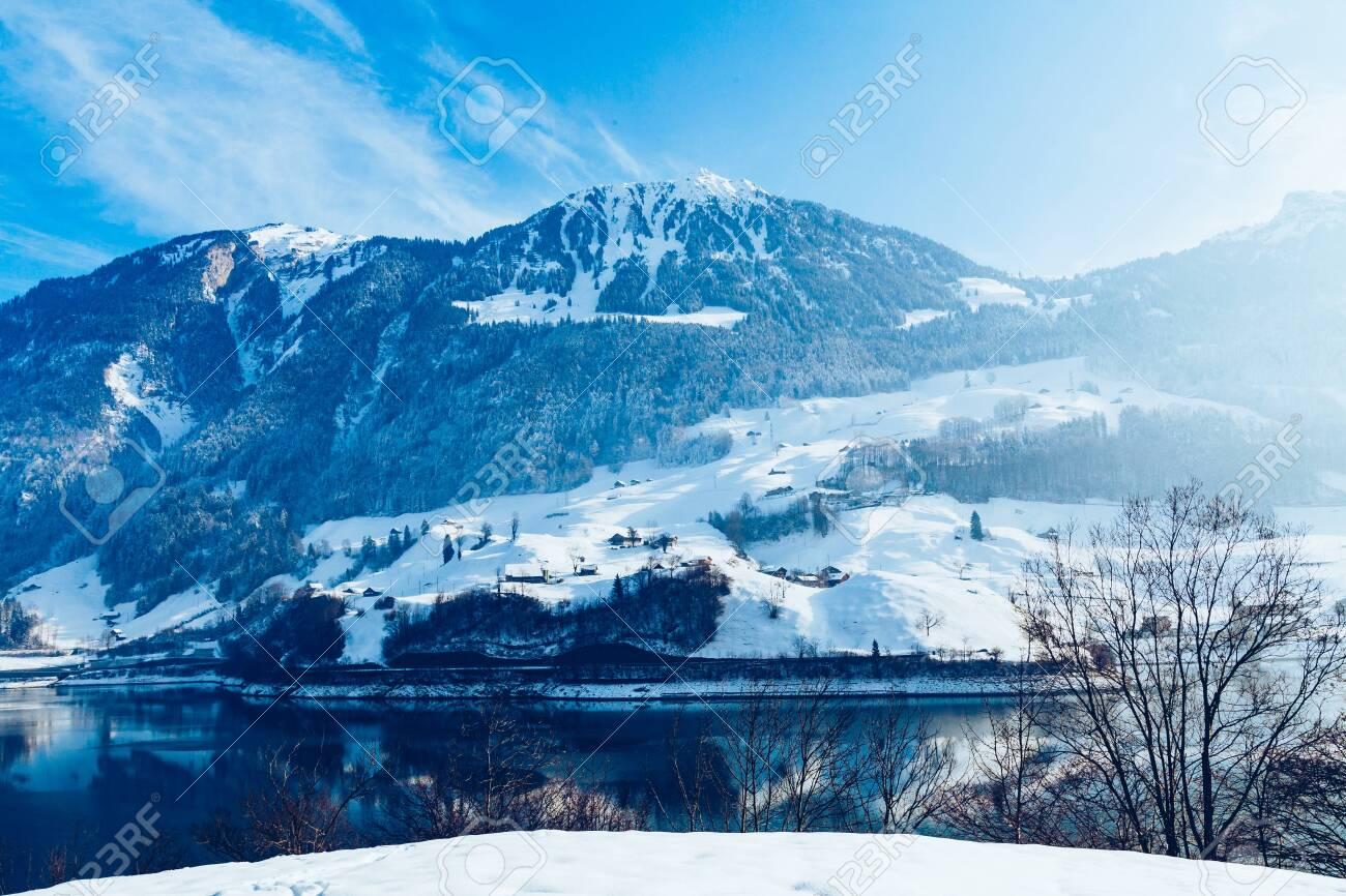 Beautiful winter lake and snowy mountains. Winter landscape - 123176745