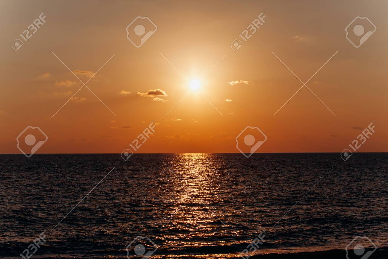 Beautiful sunset above the sea. Reflection of sunset in the water. - 137184430