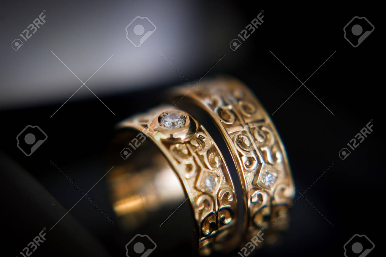 carved wedding rings with jewels, closeup - 113768190