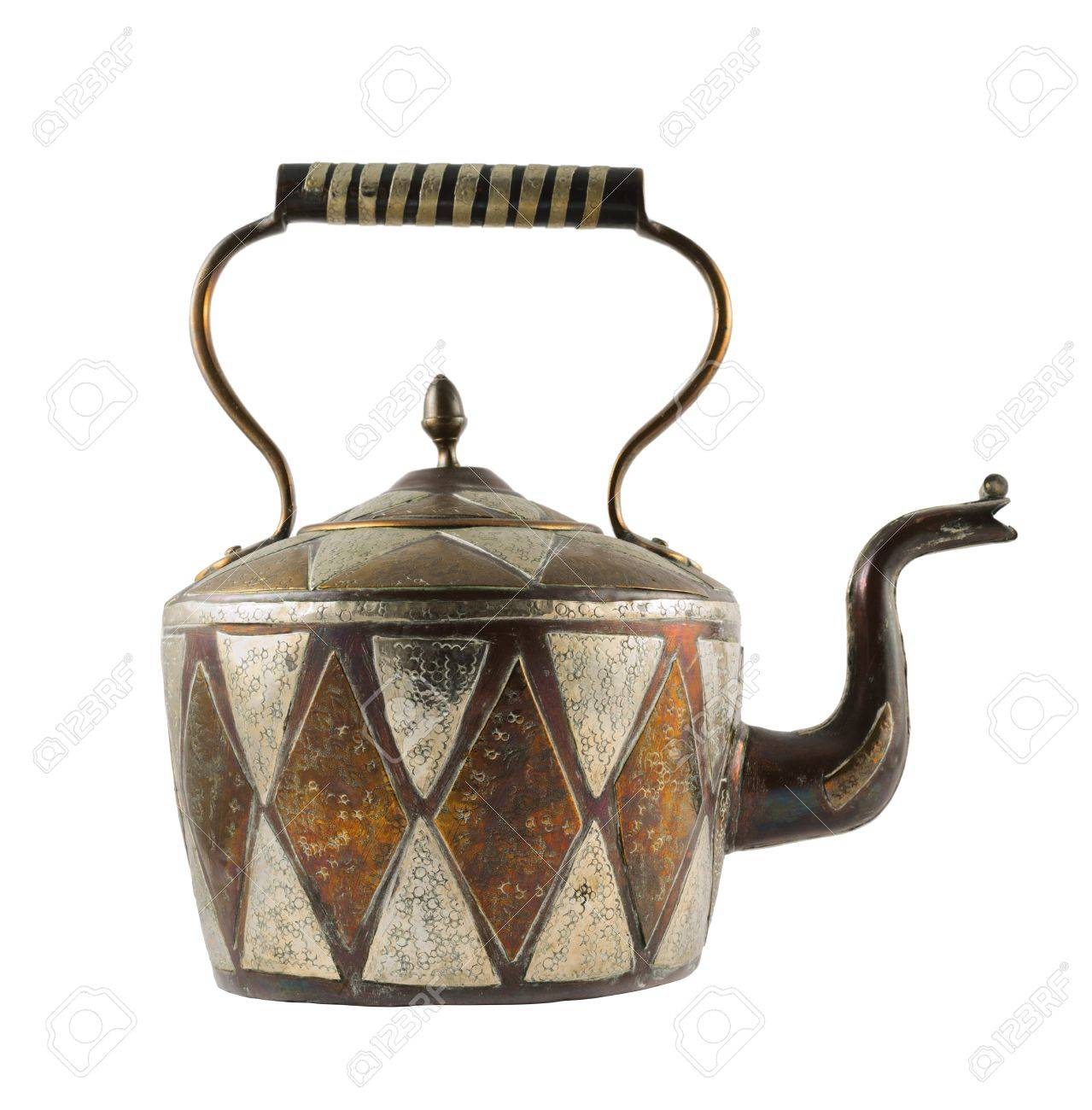 Authentic metal teapot vessel covered with ornaments isolated over white background, front view Stock Photo - 20036287