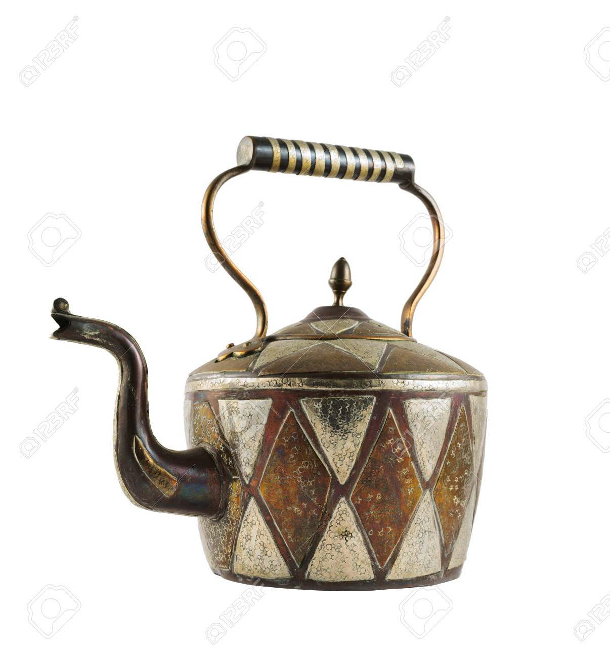 Authentic metal teapot vessel covered with ornaments isolated over white background Stock Photo - 20464388