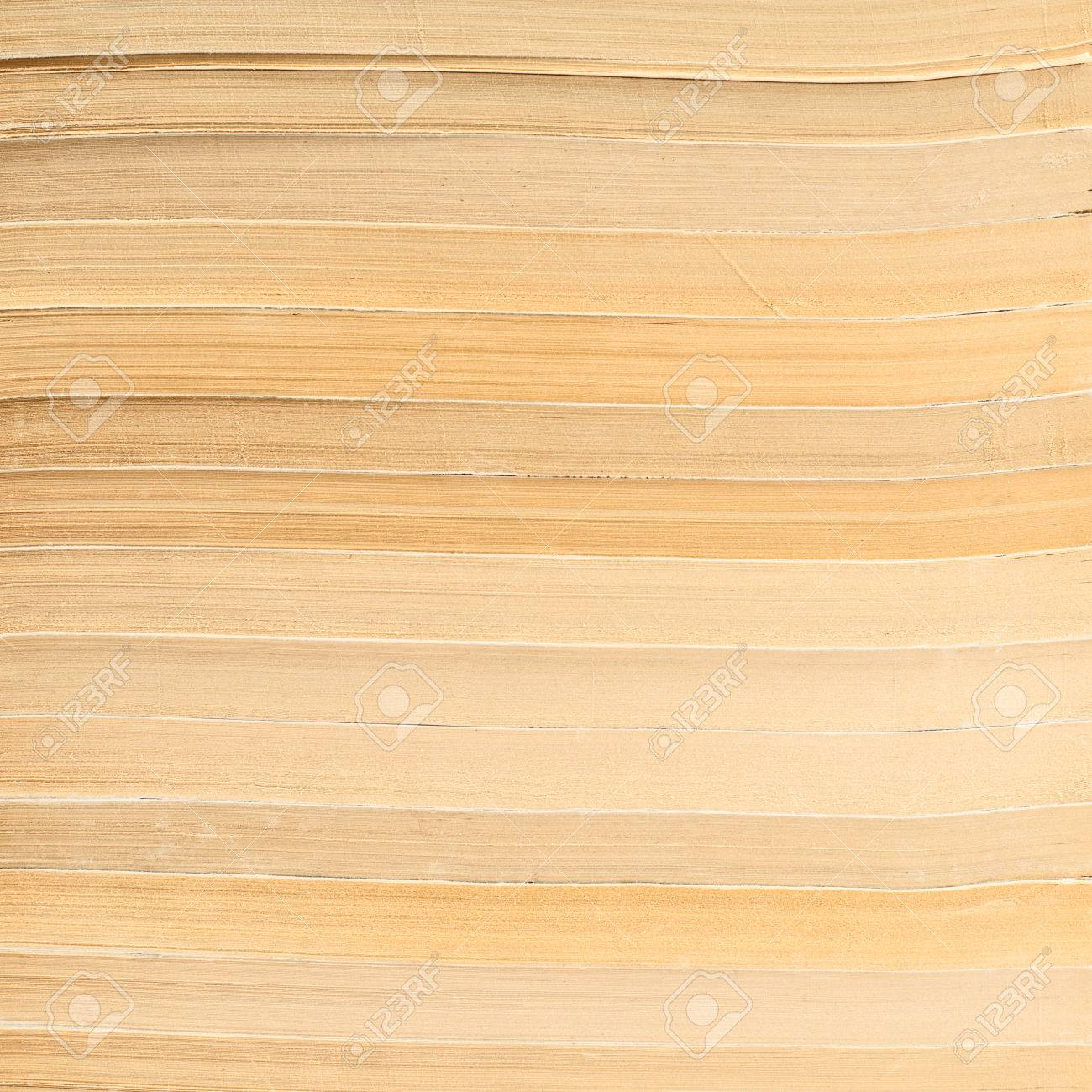 Fragment Of A Stack Old Books As Paper Background Texture Stock Photo