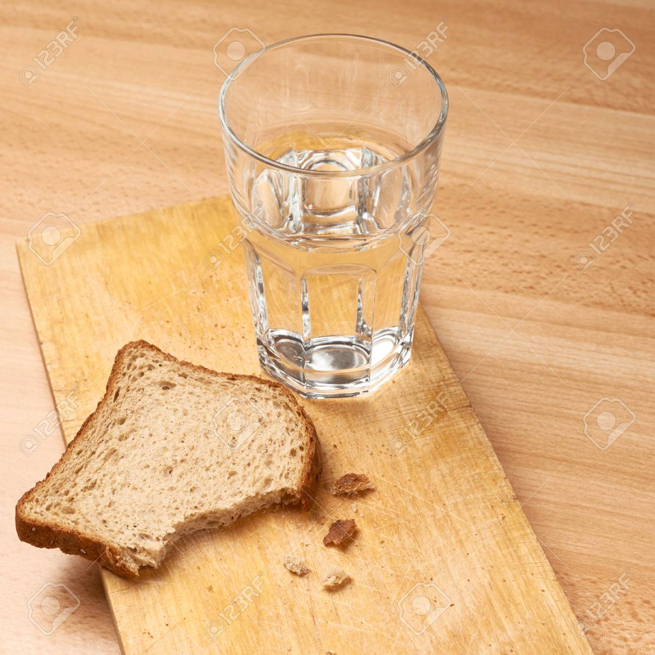 Glass Of Water And Bread Composition Over The Wooden Surface Stock Photo Picture And Royalty Free Image Image 29060880