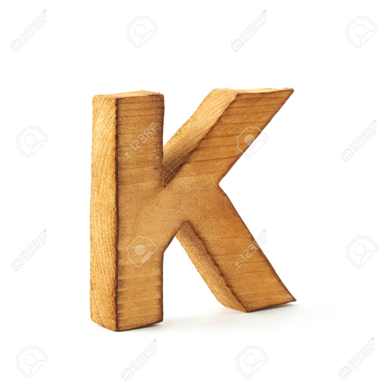 single capital block wooden letter k isolated over the white background stock photo 36074823