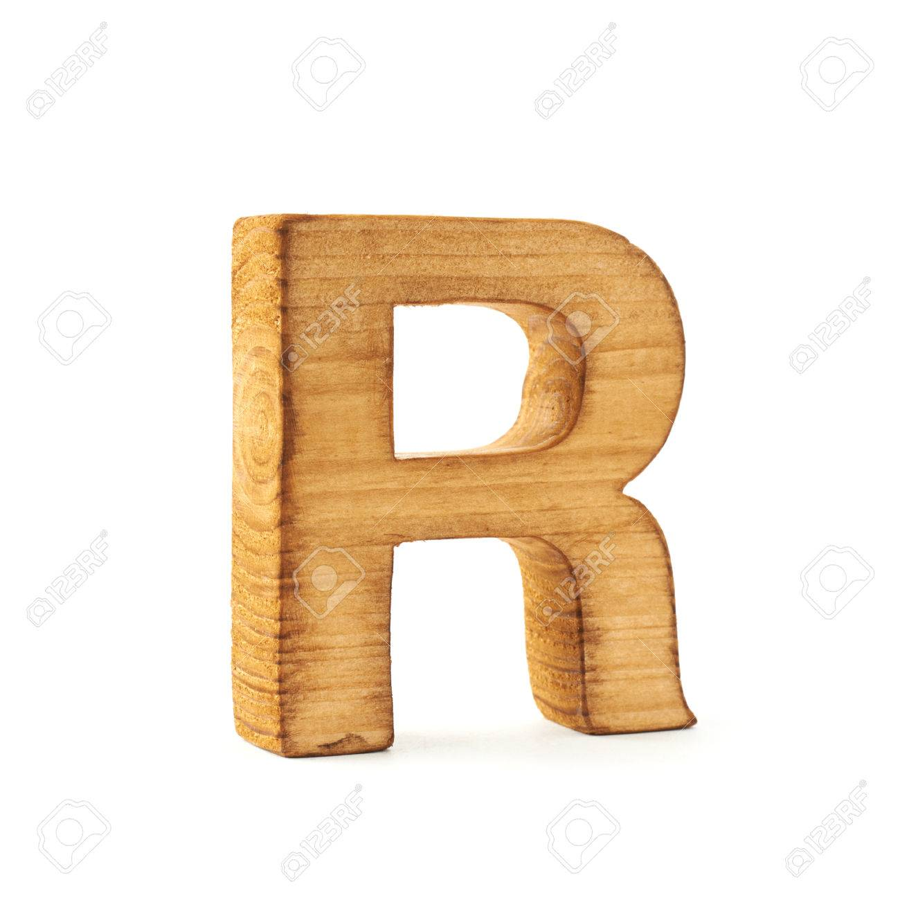 Single Capital Block Wooden Letter R Isolated Over The White