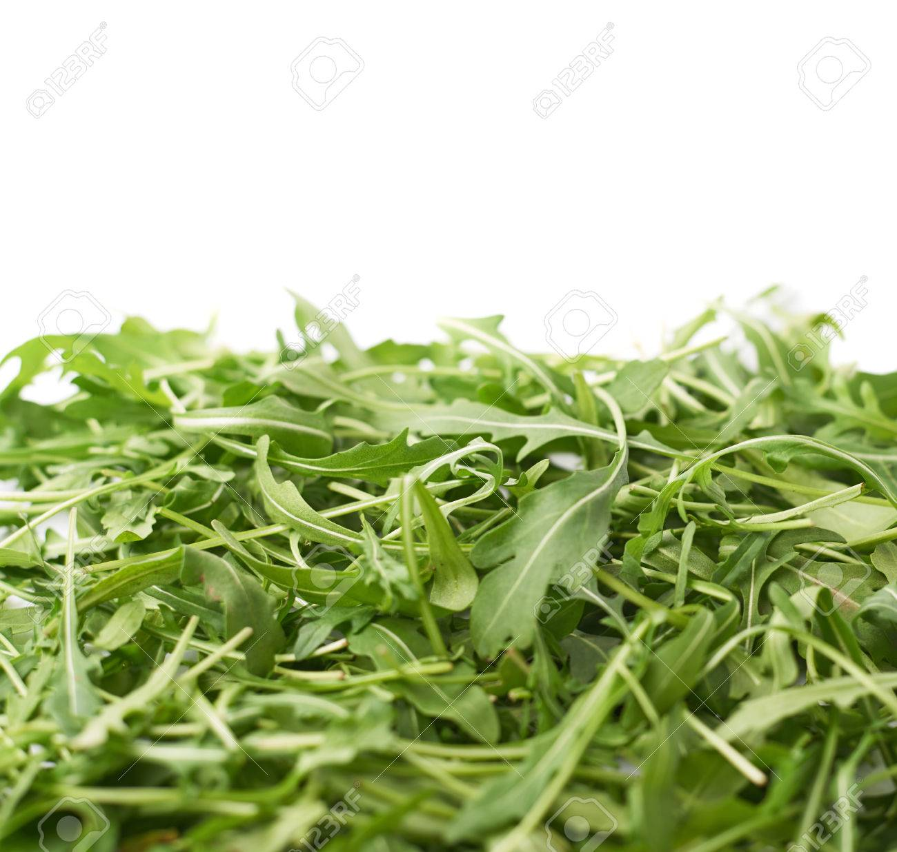 Pile Of Eruca Sativa Rucola Arugula Fresh Green Rocket Salad Leaves As A Copye Background Composition