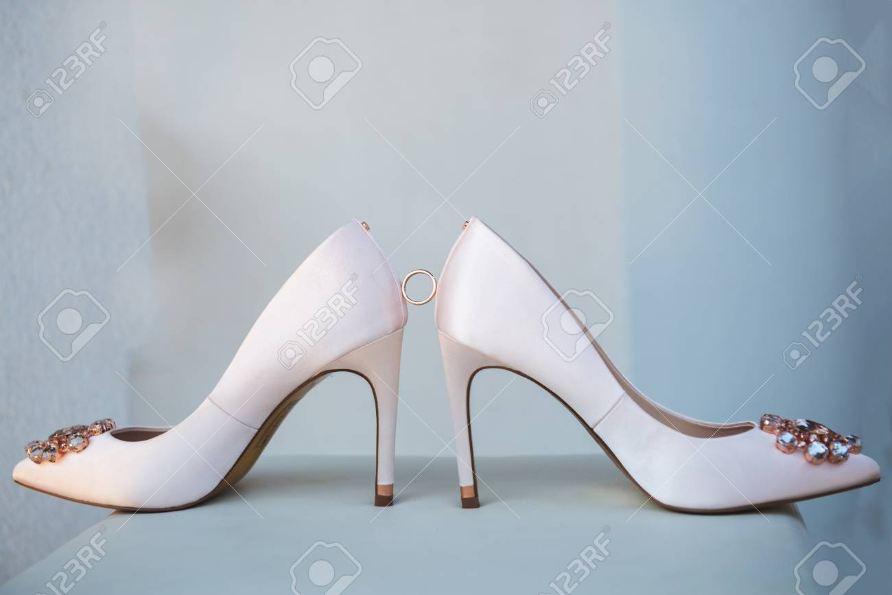 White Shoes And Ring Of The Bride . Wedding Theme Background Stock ...