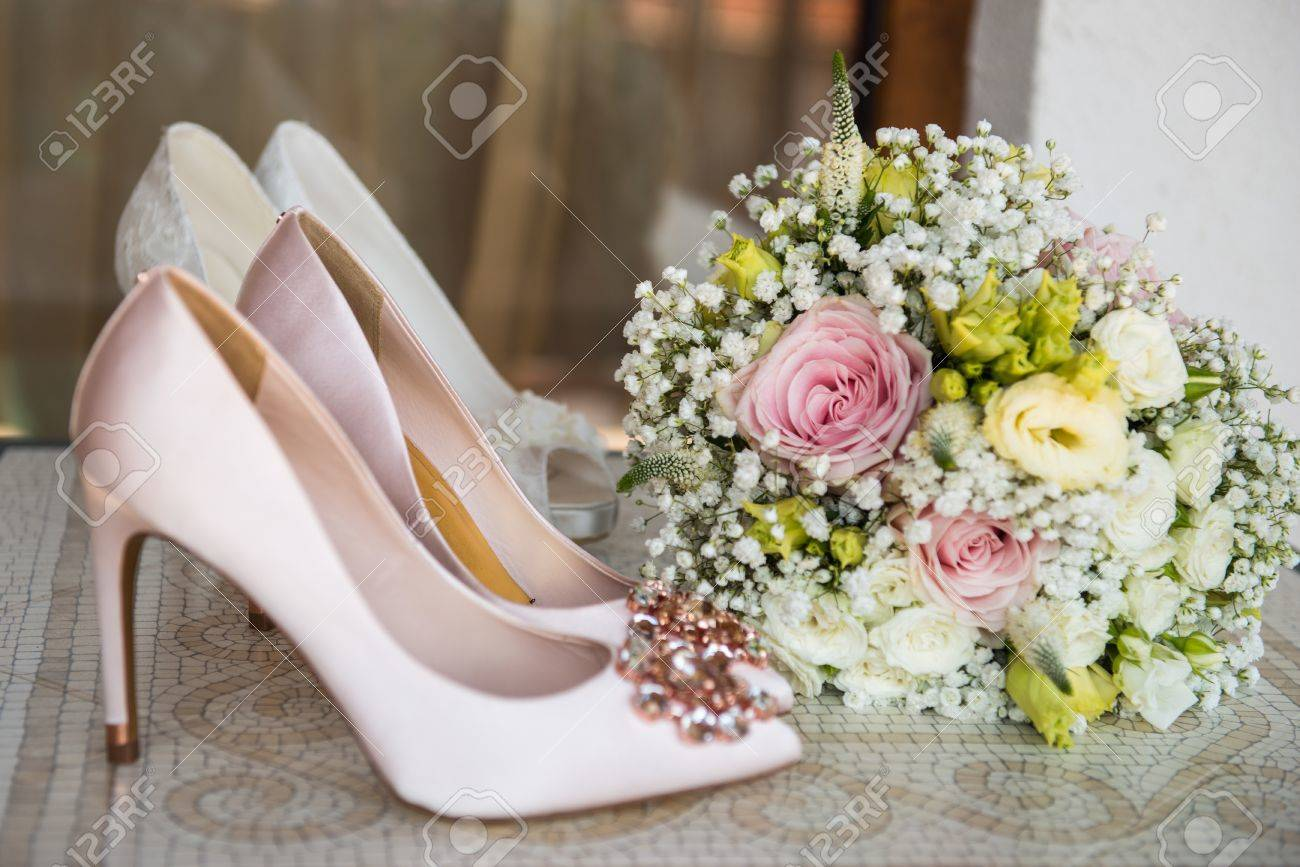 White shoes and ring of the bride wedding theme background stock photo white shoes and ring of the bride wedding theme background mightylinksfo