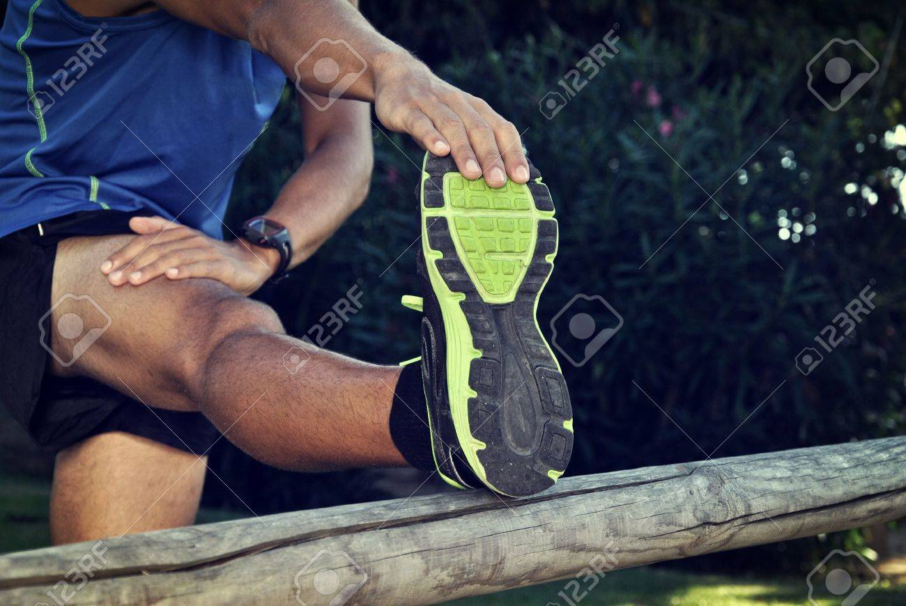 young athlete stretching before a long run - 21926476