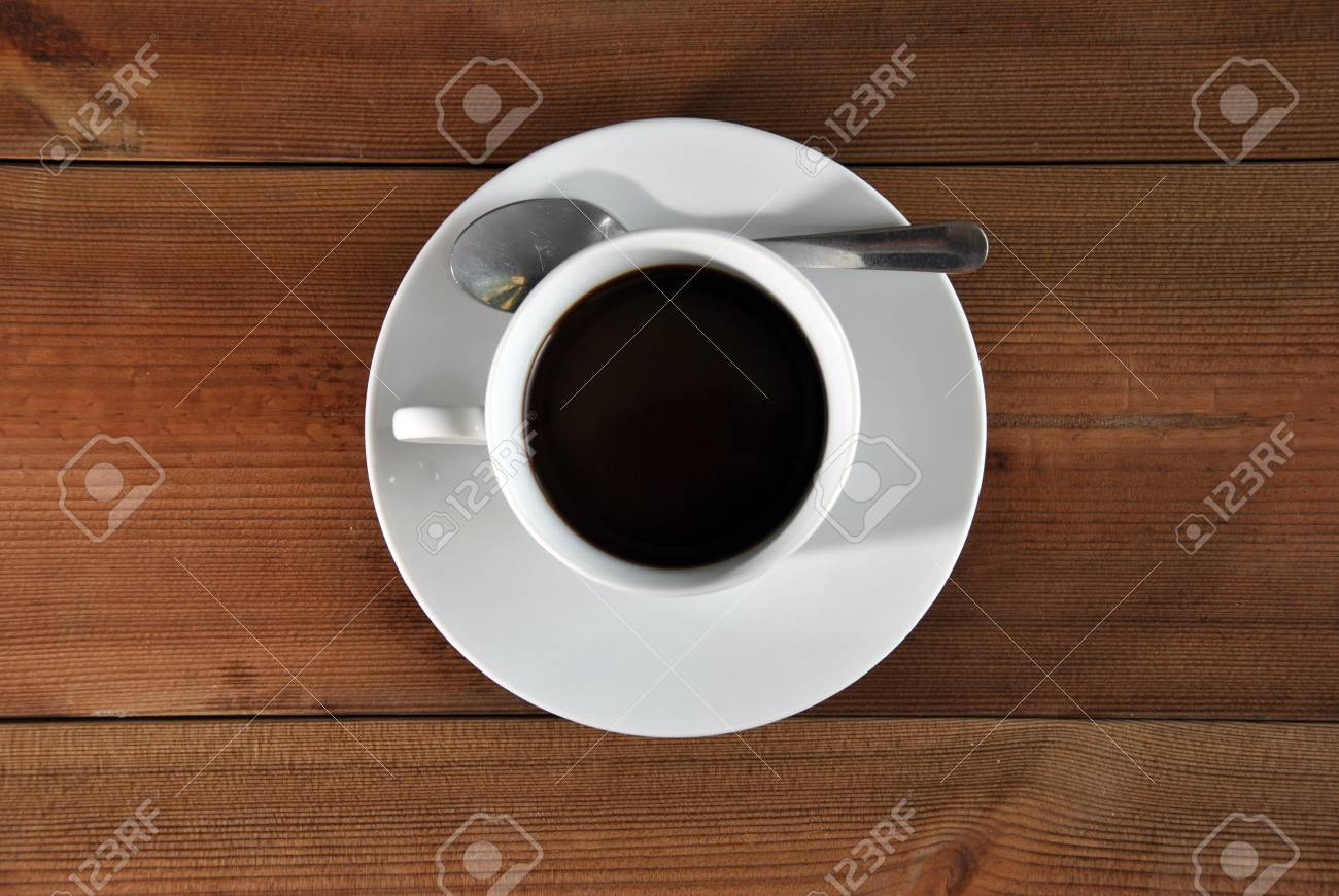 cup of coffee on a wooden table - 22885478