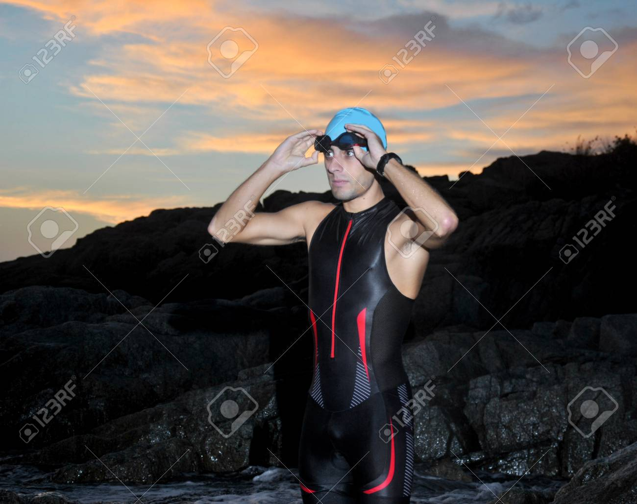 triathlon young athlete out of the sea at dawn - 23223432