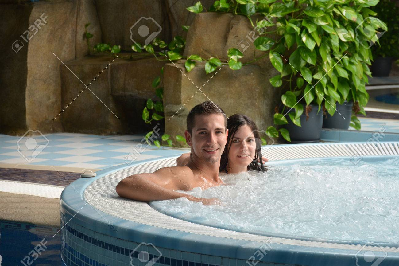 couple in love in jacuzzi enjoying a hydrotherapy session - 48357914