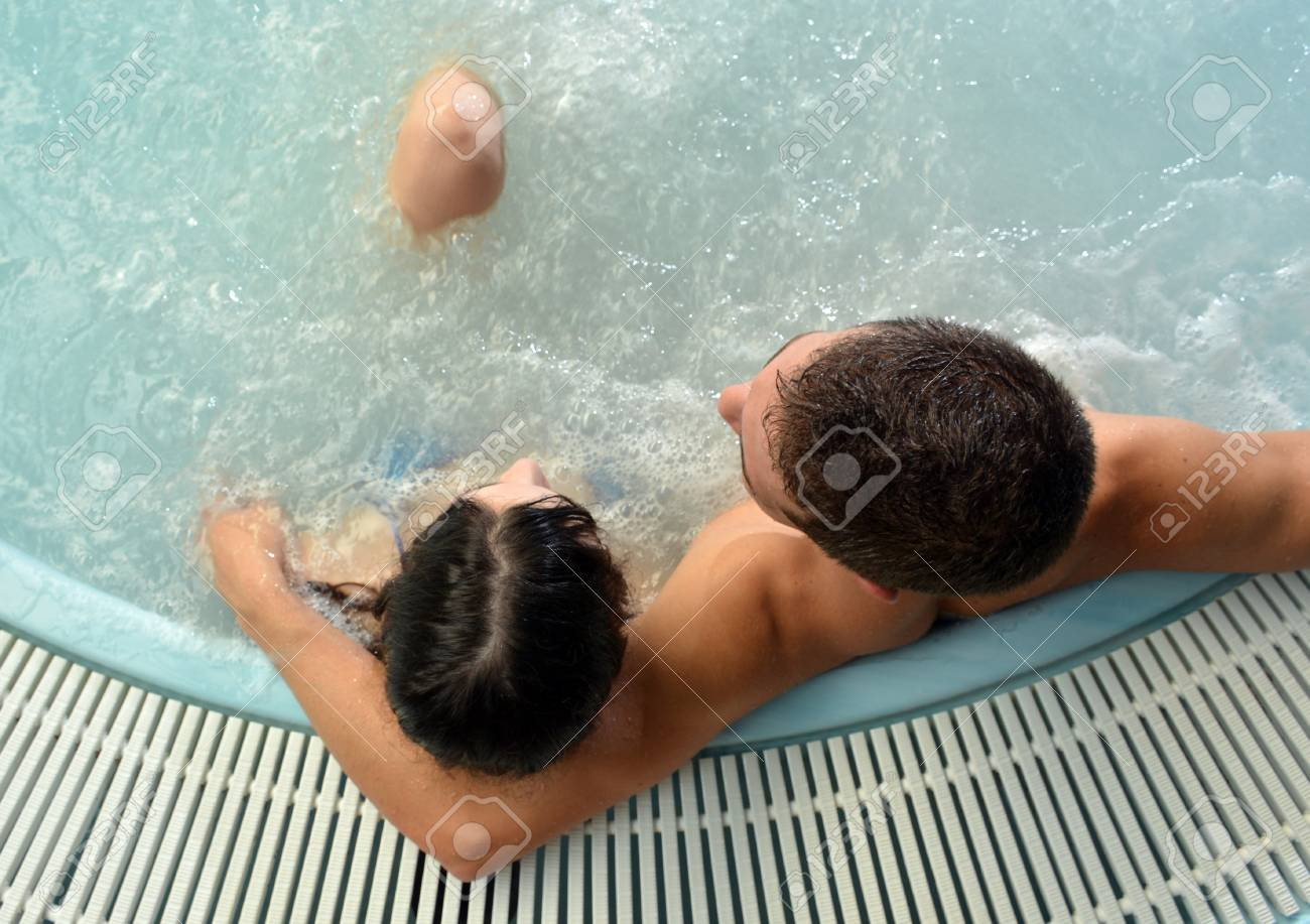 Couple In Love In Jacuzzi Enjoying A Hydrotherapy Session Stock ...