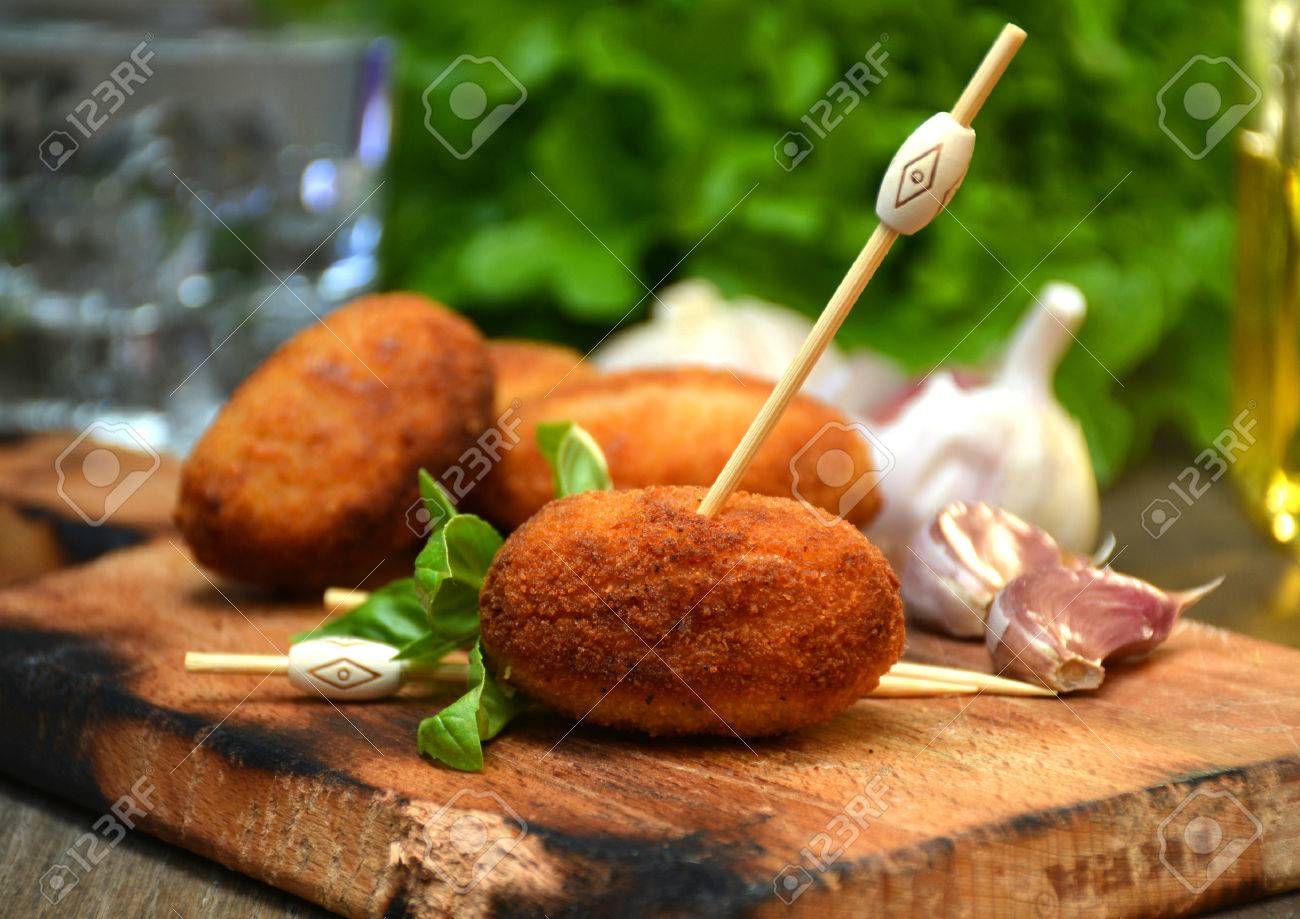 plate full of home-made croquettes of ham, typical Spanish dish - 60822156