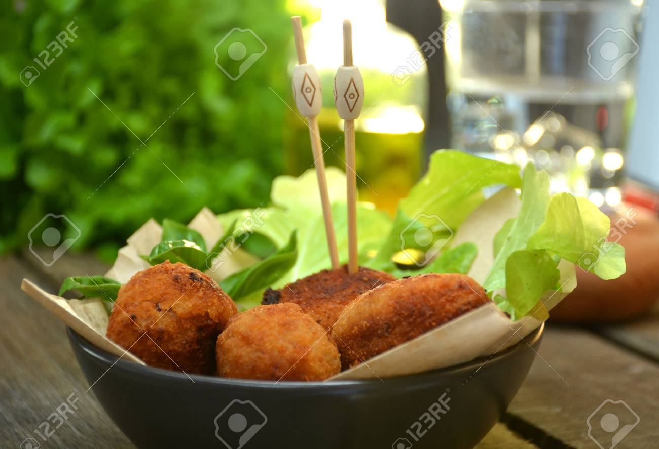 plate full of home-made croquettes of ham, typical Spanish dish - 60822158