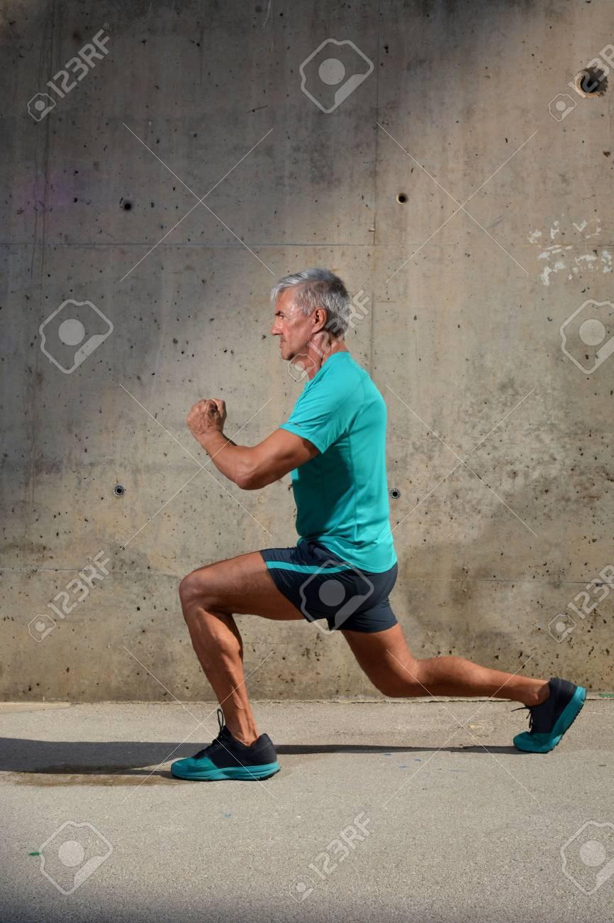 Elderly man practicing sports on the street - 60945103