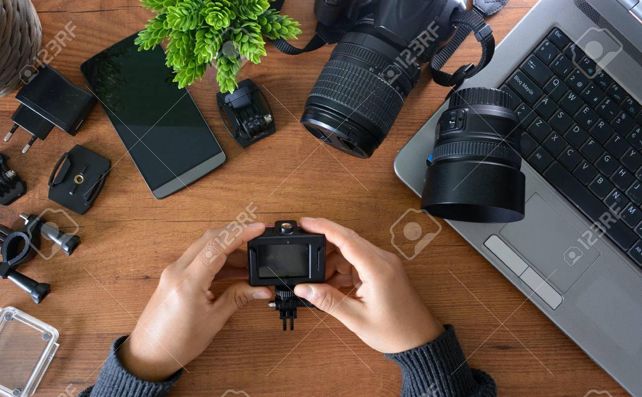 Camera's action with their accessories accompanied of a notebook and a camera reflex - 66224882