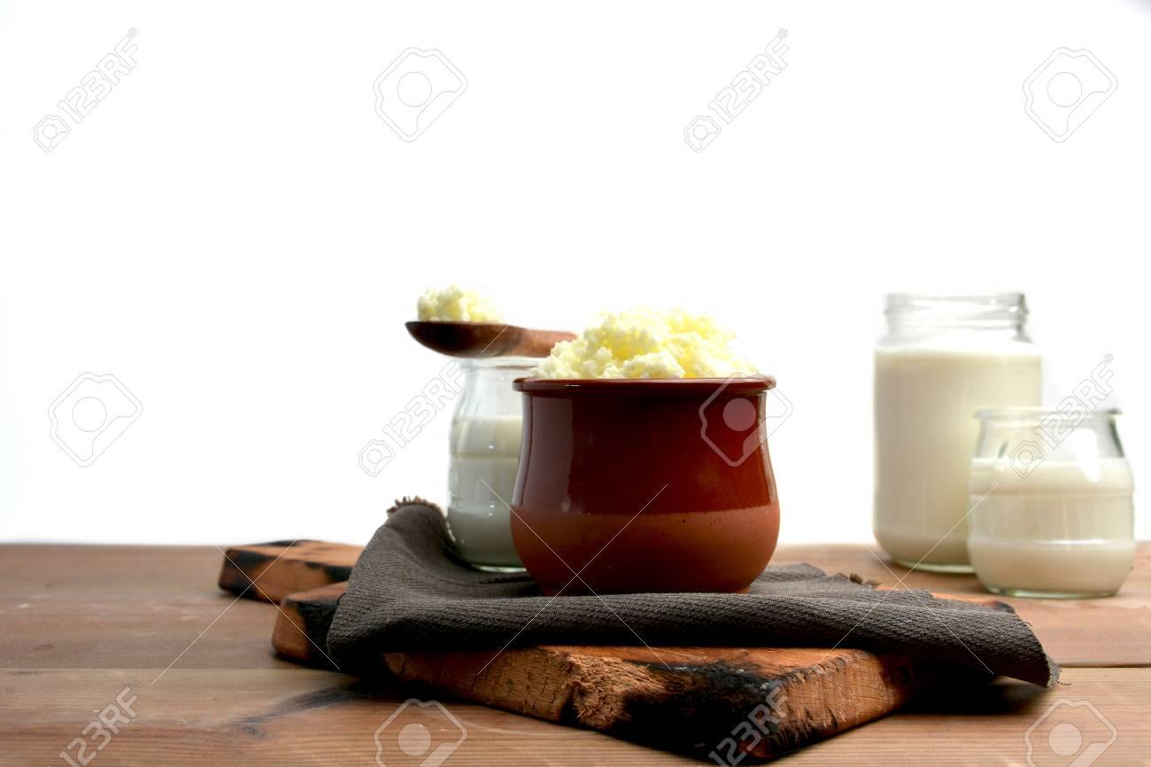 glasses full of keffir, milk and yogurt liquid on bottom white - 69912231