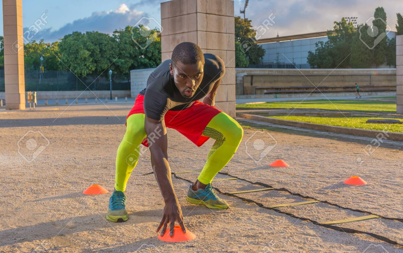 male muscular training ladder to the ground and cones. This serves to increase the speed and reflexes - 86950326