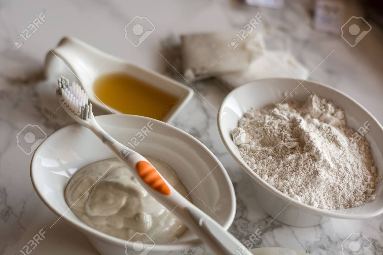 Homemade toothpaste, made with white clay, essential oils and coconut oil. Stock Photo