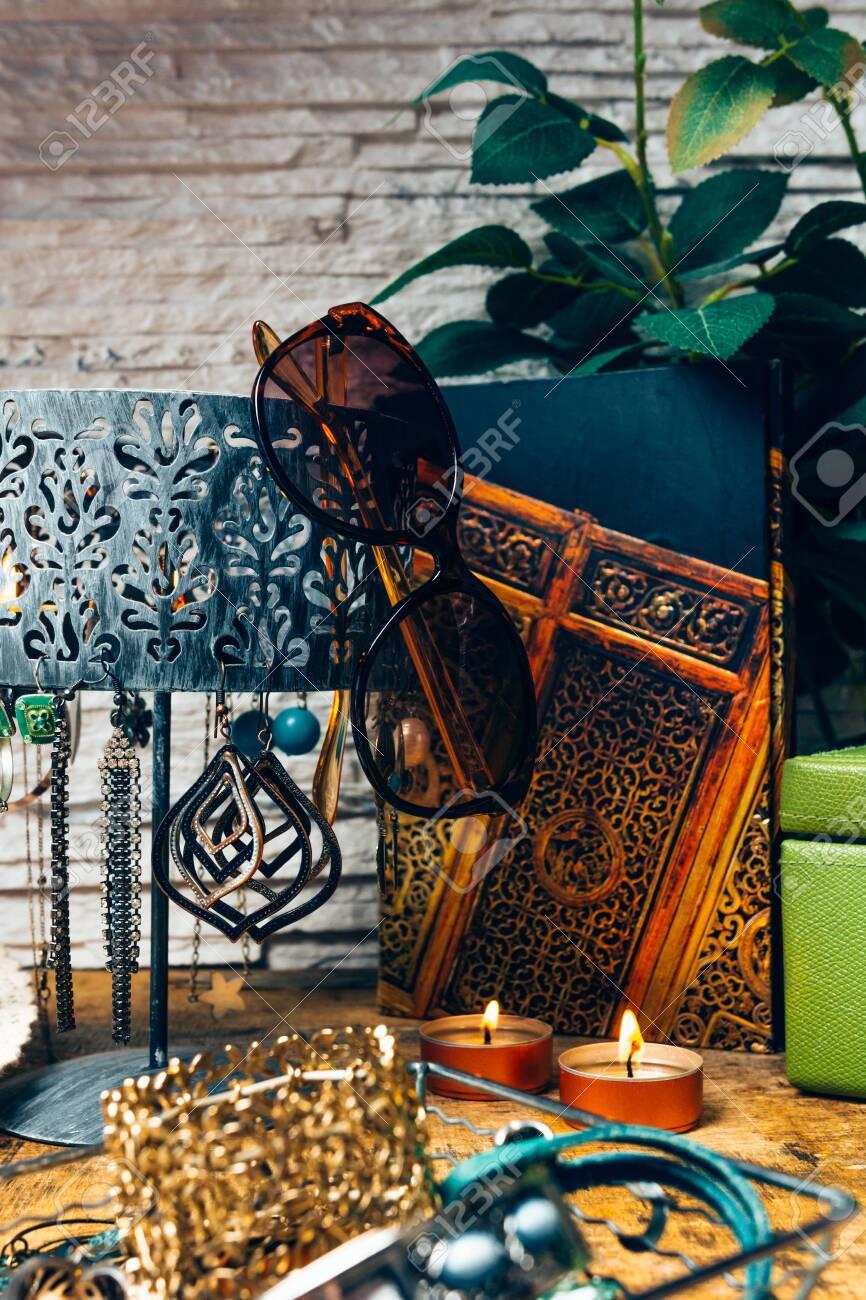 Desk full of accessories for women. - 148067627
