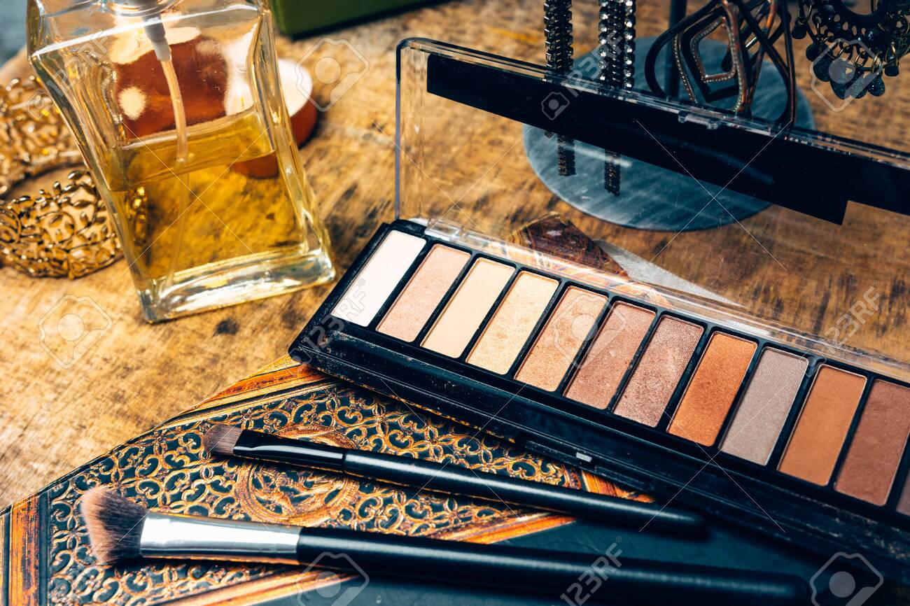 Make-up products for women on a table accompanied by different accessories - 148067629