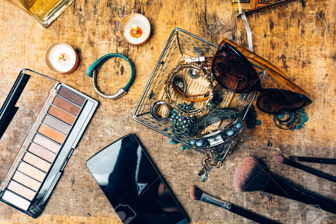 Desk full of accessories for women. - 148067630