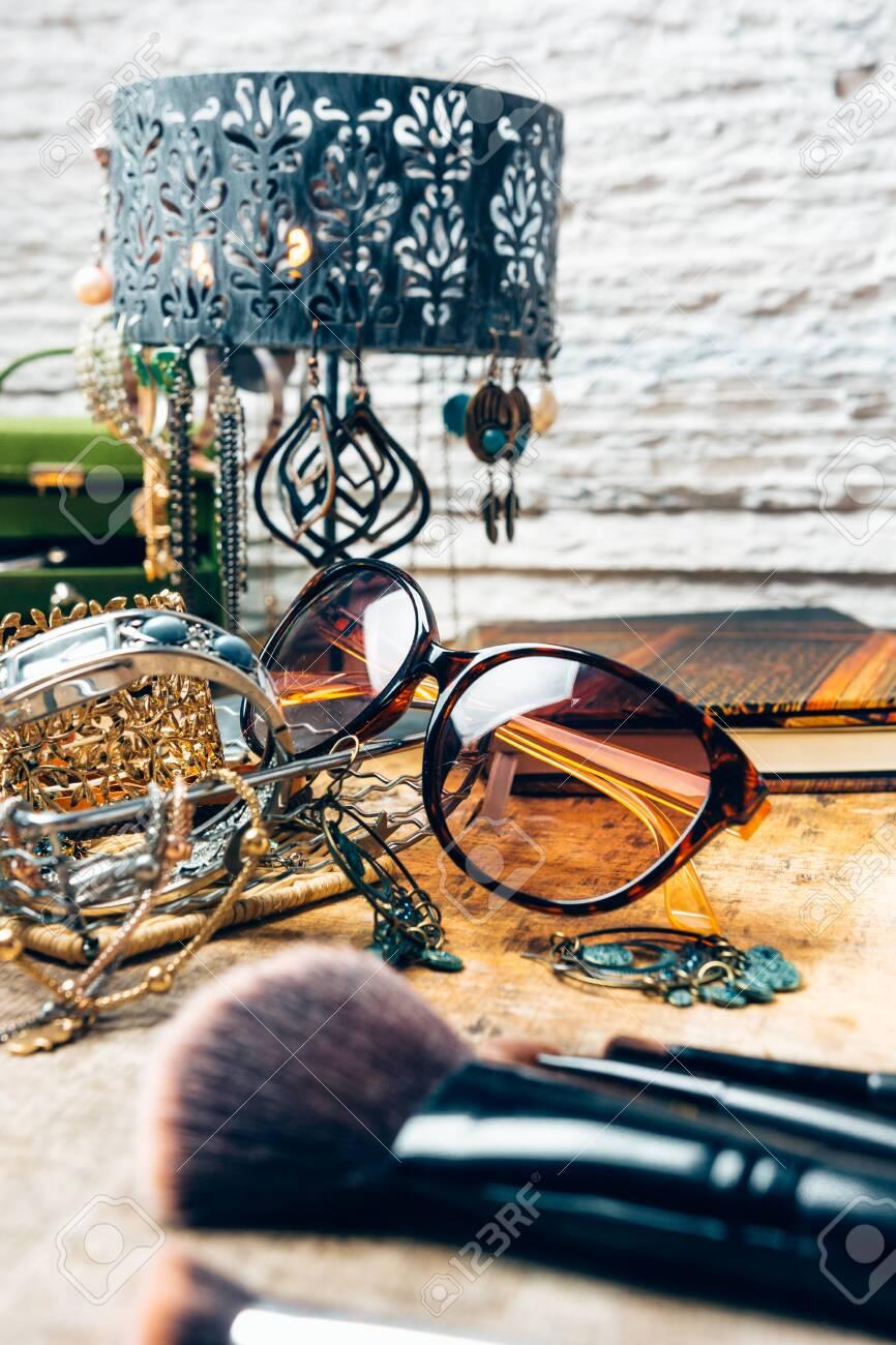Desk full of accessories for women. - 148067632