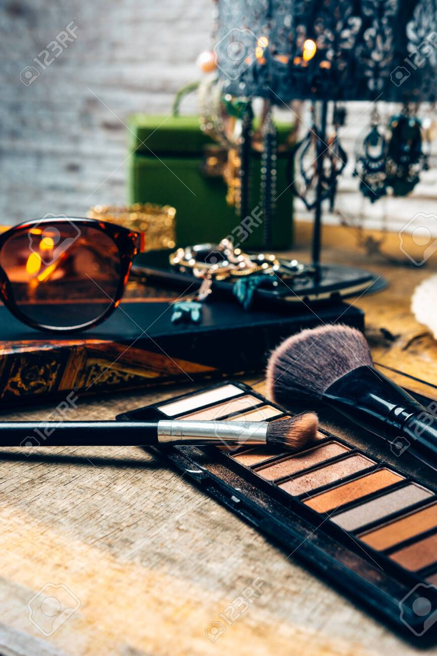 make-up products for women on a table accompanied by different accessories - 147338981