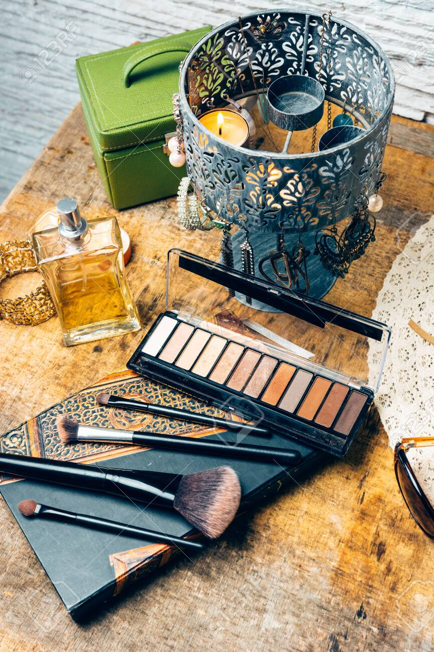 Make-up products for women on a table accompanied by different accessories - 148066550