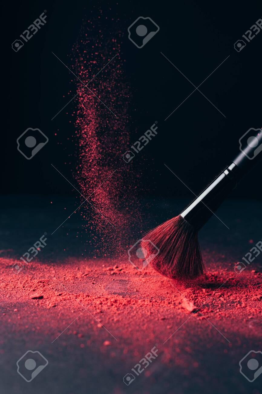 Make-up brush with violet powder explosion on black - 149348847