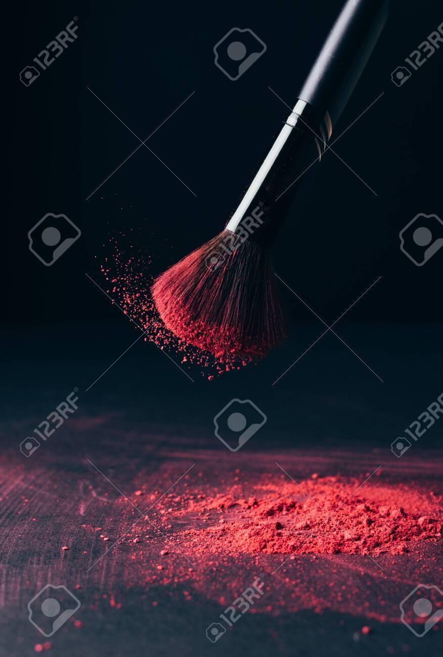Make-up brush with violet powder explosion on black - 149348848