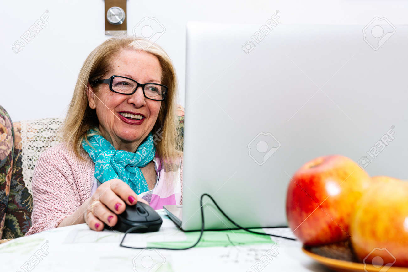 78-year-old grandmother using a laptop at home (concept of technologies for the elderly) - 169767540