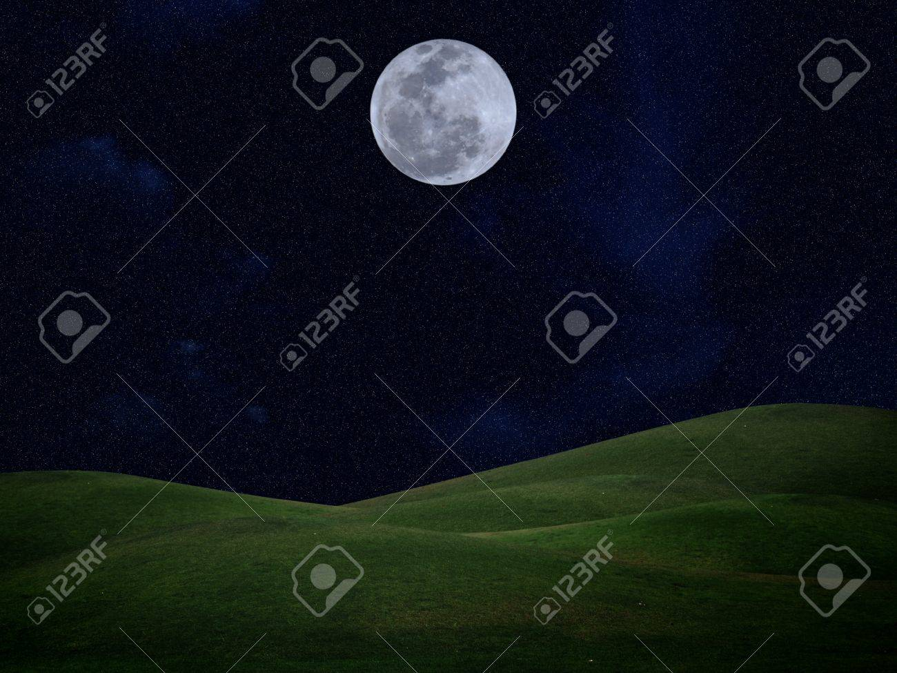 Full moon with stars and field of green hill on darkness sky Stock Photo - 10461349