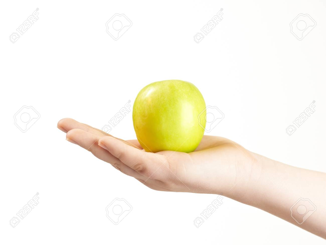 Apple in the palm og childs hand Stock Photo - 12410127