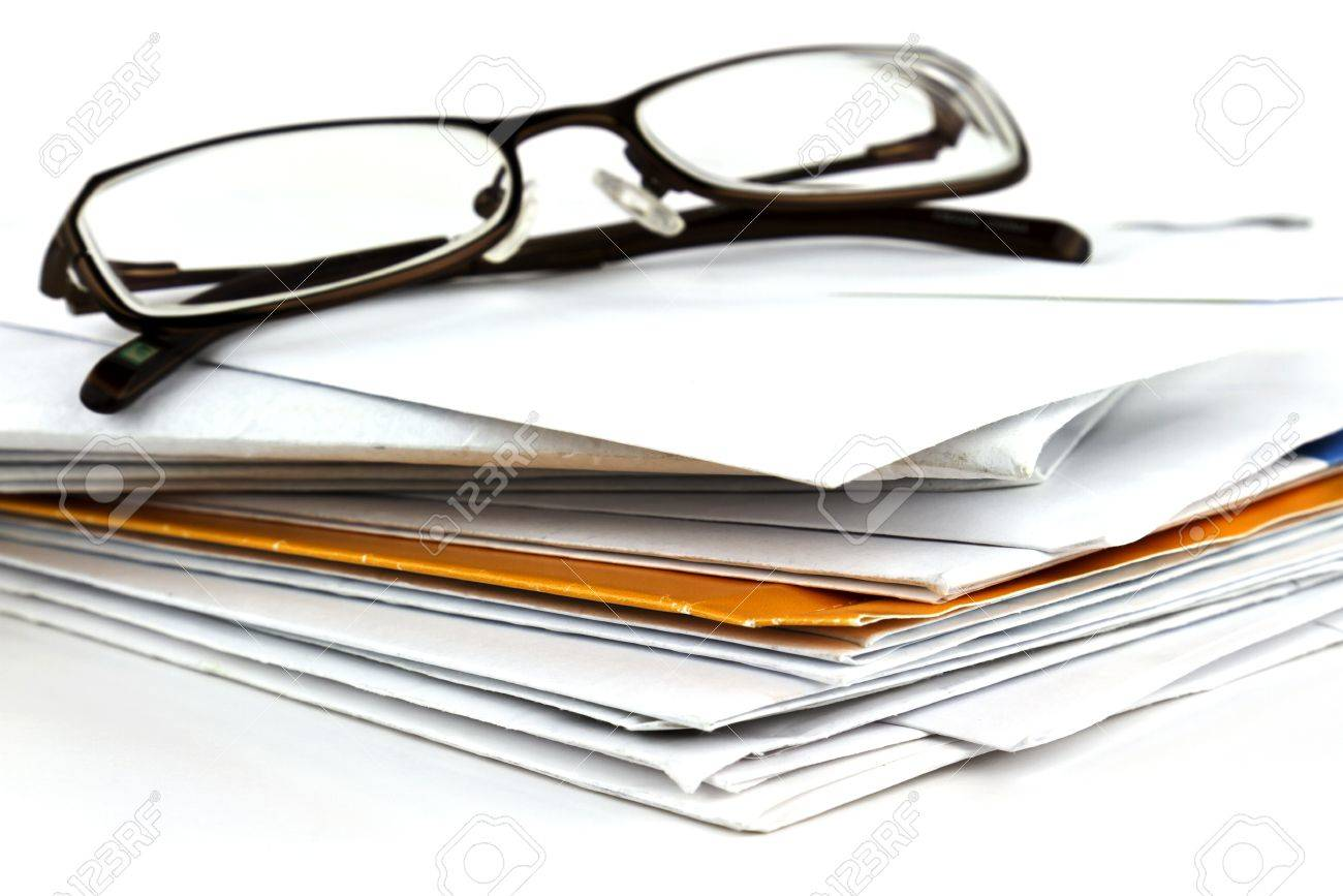 6f9ebc1f08f6 Stack of postal mail with pair of eyeglasses on white background. Stock  Photo - 16321505